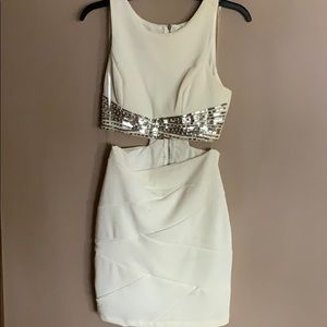 White dress with sequins. Gives two piece effect.